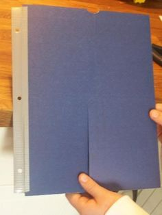 Duct tape w/ hole punch - makes the lapbooks storable within a binder!