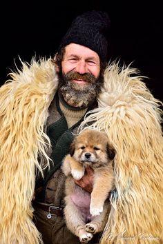 Shepherd with his dog in Simon Village, Romania - photograph by Eduard Guţescu