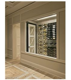 I don't know what's prettier - the wine cellar or the wood floor with tile inlays.  Gorgeous.  Beachfront New Construction Estate Home for Sale in Olde Naples, Florida