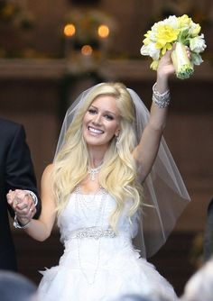 Heidi Montag looked stunning on her wedding day.  Her dress by Monique Lhuillier, her hair and most importantly the way she accessorized her jewelry were perfection!
