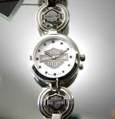Harley-Davidson Ladies Charm Bracelet Watch by Bulova Harley-Davidson, http://www.amazon.com/dp/B002RFMU6I/ref=cm_sw_r_pi_dp_Rpm9qb07PAVCF