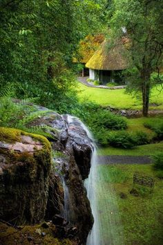 Irish cottage with waterfall.    For more interesting pictures, join: Mum he started it