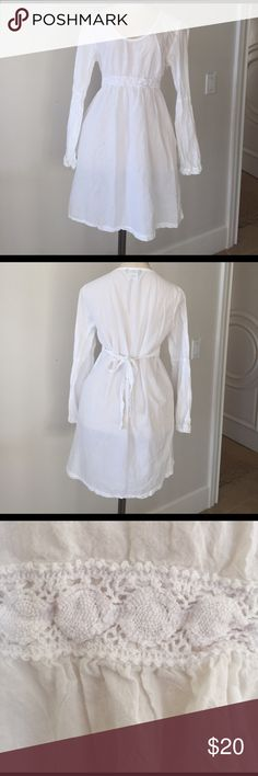 Tommy Bahama coverup Pure white Tommy Bahama coverup with crochet detail at waist and on sleeves.  Worn once and in excellent condition. Tommy Bahama Swim Coverups
