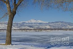 A winter landscape view of the Twin Peaks, Mt Meeker 13,911 ft and Longs Peak 14,256 ft across a frozen McIntosh Lake, North West Longmont Colorado.  Fine art photography prints, decorative canvas prints, acrylic prints, metal print wall art for sale on FineArtAmerica.com. Prints starting at $25. Copyright: James Bo Insogna
