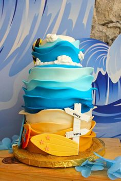 This cake with waves would look sweet with fish in a coral reef at the bottom instead of surf boards