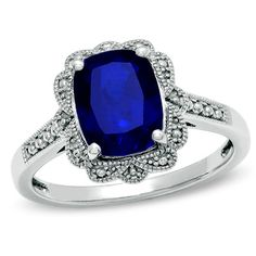 Cushion-Cut Lab-Created Sapphire Vintage Ring in Sterling Silver: Ooh, I adore this setting. Still don't know if I can commit to a colored stone (I got back and forth), but slap a white sapphire in there, and you'd be good to go.