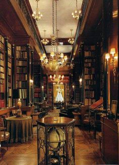 Edinburgh Library, Edinburgh, Scotland. The wooden panelling, the chandeliers and the walls filled with books make this library seem so inviting.