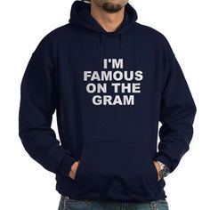 (FRONT) Men's dark color navy blue hoodie with I'm Famous On The Gram (Instagram) theme. Instagram is one of the most used platforms that has catapulted careers, discovered new stars, fascinations and created successful businesses. Available in black, navy blue; small, medium, large, x-large, 2x-large, 3x-large size for only $48.99. Go to the link to purchase the product and to see other options – http://www.cafepress.com/stifotg