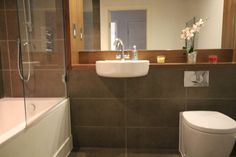 Mocha: Gemini Young Stone 600x300mm £29.96 per sqm (These are tiles in Kath's bathroom wall and floor).