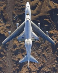 The space shuttle Endeavour,fresh from the mission and mounted atop its modified Boeing 747 carrier aircraft, flies over California's Mojave Desert on a three-day trip back to the Kennedy Space Center in Florida on Wednesday Dec. By AP Photo/NASA Jets Privés De Luxe, Cool Pictures, Cool Photos, Random Pictures, Funny Pictures, Funny Pics, Funny Memes, Air Space, Space Age