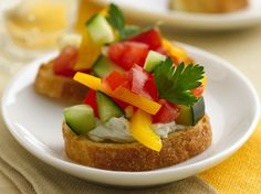 Appetizer ready in 40 minutes! Try this tasty bread appetizer topped with cucumber and tomato mixture layered with cheese.