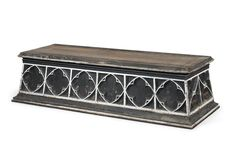 A VICTORIAN GOTHIC PAINTED PINE COFFIN STAND  MID-19TH CENTURY  In the form of a plinth, with blind quatrefoil carving to each side and two carrying handles to each short end 25 in. (64 cm.) high; 96 in. (244 cm.) wide; 36 in. (91.5 cm.) deep