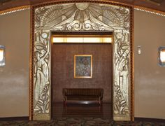 Interior, Paramount Theater, Oakland, California by Sandra Cohen-Rose and Colin Rose  Entrance to a men's room, flanked with that gorgeous gilded sculpture work.