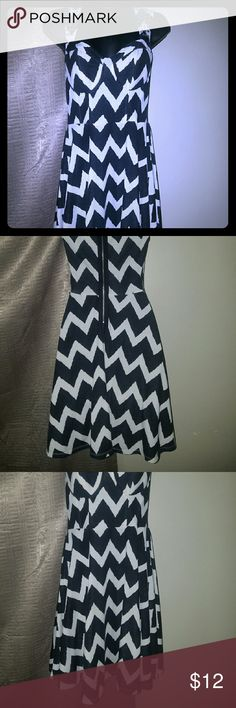 Black and white Chevron dress This dress is flatterinf. Snug in the waistline and a tiny flare at the bottom. Studs on the straps for embellishments, built in bra cups. Great condition! Dresses Midi