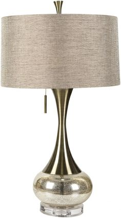 The glass and metal base on this lamp has a spectacular silhouette. Lighting by Surya. (LMP-1059)