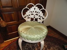Vanity chair redone by painting with pearl metallic spray and using a pillow purchased at Ross Dress for Less for 9.99 .  Removed some of stuffing from pillow and attached pillow to wood circle with staple gun.