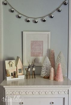 This jingle bell garland and little pink snow cottage from HomeGoods adds a sweet Christmas touch to this girls' pink and gray bedroom. #sponsored #HomeGoodsHappy