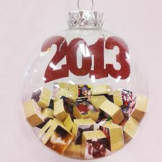 Fill our glass ornaments with wood blocks/Scrabble tiles covered with photos of what you did this year. Too fun!
