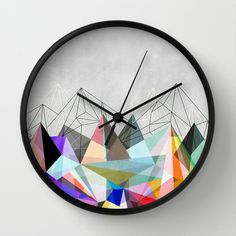 """ColorFlash wall clock Available in natural wood, black or white frames, our 10"""" diameter unique Wall Clocks feature a high-impact plexiglass crystal face and a backside hook for easy hanging. Choose black or white hands to match your wall clock frame and art design choice. Clock sits 1.75"""" deep"""