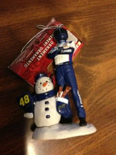 """2011 Nascar #48 Jimmie Johnson Figurine Christmas Ornament by NASCAR. $12.99. handcrafted. Approx. 4"""" Tall. Official NASCAR Licensed collectible product. NASCAR certificate of Authenticity. This collectible ornament has Jimmie Johnson standing in his racing attire and helmet. There is a snowman beside him with number flag (48) and signature (Jimmie Johnson) stocking."""