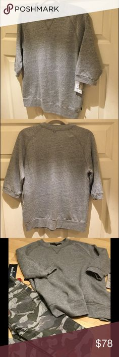 NWT True Religion 3/4 Raglan Sweatshirt Super comfy True Religion Joan Smalls 3/4 length raglan sweatshirt in gray.  True Religion logo tag at hip and stitched logo at back of neck.  51% Polyester/ 44% Cotton/ 5% Rayon.  Make an offer! True Religion Tops Sweatshirts & Hoodies