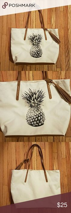 Sonoma Pineapple Tote Super cute! Pineapple design in black. Brand new, even has plastic covering on magnetic closure (see 4th pic). Length: 18in, Height: 12in, Width: 6in. Two open pockets on inside front and one zippered pocket on inside back. Sonoma Bags