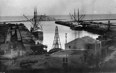 (ca. 1902)* - Early 1900s view of L.A. Harbor showing fishing boats anchored in the harbor at San Pedro. Deadman's Island is behind. Railroa...