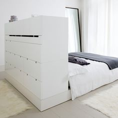 White bedroom with headboard cupboards