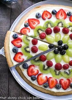 Dessert Pizza with fresh fruit - A vibrant, delicious dessert pizza with a sugar cookie crust and cream cheese frosting!