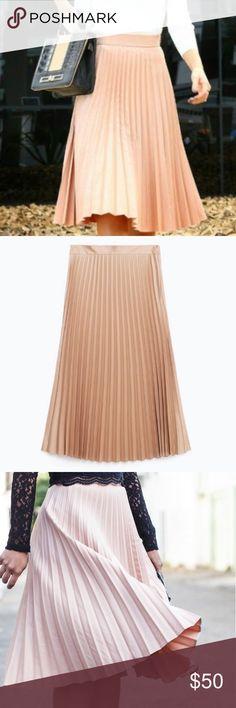 Zara pleated midi skirt in blush Zara pleated midi skirt in blush. Size XS. Great condition. 73% polyester/25% viscose/2% elastane. Machine wash. Zara Skirts Midi