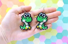 """229 Likes, 27 Comments - Mini Fuse Bead Pixel Art ❤✨ (@hicelina) on Instagram: """"I absolutely adore these chibi Yoshi earrings! One of my favorite designs that I have made. I think…"""""""