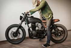 "Fade To Black"" is the name of the latest build to roll out of the Federal Moto workshop. Commissioned by Grant Harvey, a Canadian film and television director, the sleek bike started off as a 1975 Honda CB550, but Federal Moto gave it their trademar"