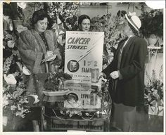 This photograph depicts three unidentified women with an American Cancer Society poster and coin can.  It is dated 1950 on the back, but it does not say where it was taken.  However, it was included with a series of photographs taken in Gary, IN.  From my personal collection.