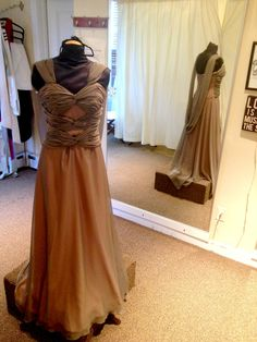 Moms! Don't be typical! Don this gown at your daughter's/son's big day and make your presence known WITHOUT understating the bride! This Paula Varsalona frock comes in a variety of colors, so come on in and try it on at Dressed to the Nines! #paulavarsalona #mob #bridal #glamorous