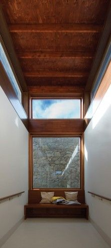 Bench at the end of the bedroom wing corridor Alzheimer's Respite Centre, Dublin, Ireland by Níall McLaughlin Architects