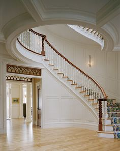 entry with curved staircase overlook from second story