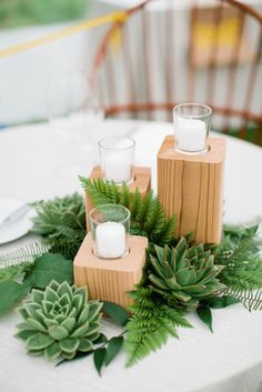 Wooden Candle Holders with Greenery.