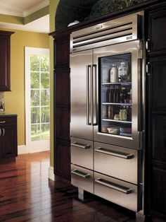 """Sub-Zero PRO 48, a four-foot bruiser with a glass door. """"With this fridge, there's no need to add art to the kitchen,"""" says designer Kathleen O'Neill, from The Design Within. """"This is art!"""" The side-by-side refrigerator and freezer with glass door is a """"foodie's dream,"""" she adds, and, """"just-harvested food from the local farmers' market looks beautiful behind the glass door."""" Photo courtesy of Sub-Zero"""
