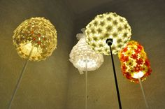 Lamps are made from PET bottles and jerrycans; the chandelier is made from umbrella handles and strainer. The mirror is made from used bicycle chains; the coat hanger is made from an old ski. Fire Basket, Light Garland, Pet Bottle, Bottle Lights, Home Lighting, Lighting Ideas, Recycle Plastic Bottles, How To Make Light, Coat Hanger