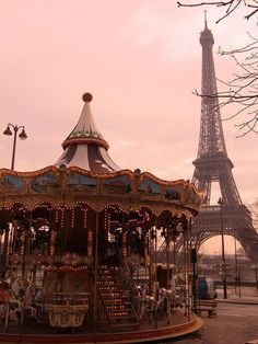 The Eiffel Tower and carousel, Paris, France.