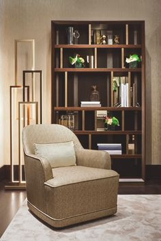 """The """"Symphony in Beige"""" living and dining room by Oasis features a Magritte bookshelf, perfect for book of any size, a Dauphine armchair, covered with fabric with special texture and an Edge floor lamp, for a dramatic Art Déco effect."""