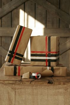 <3 brown paper wrapped presents...will match burlap stockings, etc.