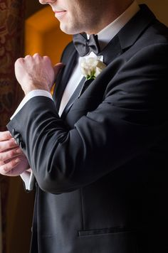 A classic shot of the groom doing up his cufflink. photo: www.eyecontact.ca