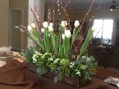 Spring still seem a long way off? Love this mix of winter greens and white tulips. #Hope