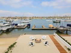Balboa island homes. This beach house offers a rare, private backyard on the Bayfront spanning nearly 50' including patio, firepit, and a private boat slip that can accommodate a vessel of more than 50'. Winkle Custom Homes. Melissa Morgan Design. Ryan Garvin Photography