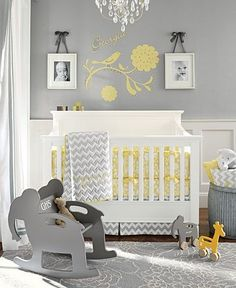 Grey and yellow nursery. Love the picture frames