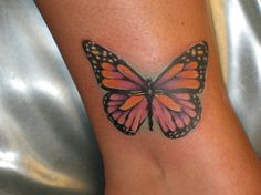 One of the most popular tattoo designs in the world is the butterfly tattoo. The butterfly tattoo is mainly worn by women. Butterfly tattoos can also hold symbolic importance to those who wear this beautiful tattoo. Just like all animal tattoos, the. Butterfly Ankle Tattoos, Monarch Butterfly Tattoo, Butterfly Tattoos Images, Ankle Tattoo For Girl, Butterfly Tattoo Designs, Tattoo Designs For Girls, Tattoo Images, Butterfly Symbolism, Insane Tattoos