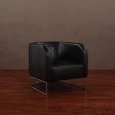 With its sleek upholstery and modern design, this black leather lounge chair is sure to become the focal point of your decor. Crafted with a high-polish base, the chair features high arms and a padded seat, so you can relax in comfort.