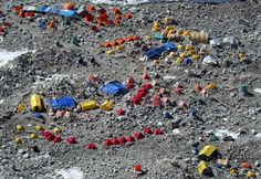 An aerial photograph of Everest Base camp, a large tent city full of climbers at 18,000 ft. May 15, 2003 which sits at the foot of Mount Everest on the Nepal-Tibet border. A record 1,000 climbers plan assaults on the summit of Mount Everest to celebrate the 50-year anniversary of the first successful assault on the World's tallest mountain. (Paula Bronstein/Getty Images)) #