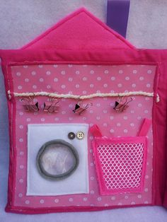 Dollhouse quiet book laundry room with a washing machine that opens and has a clear vinyl window. Clothes can be put in the machine and the laundry basket. Small clips are sewn onto rope to hang the washing up. https://www.facebook.com/sparklesandstring